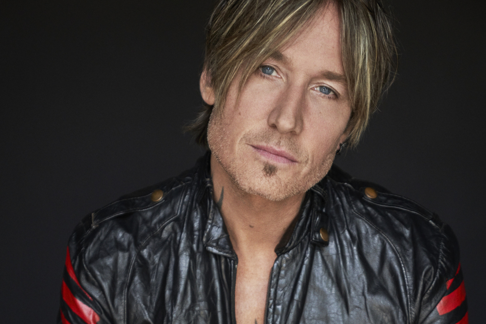 Keith Urban says he\'s found a balance between his touring commitments and home life